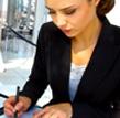 Woman sat writing her personal development plan