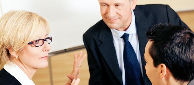 Advisor talking clients through their career assessment