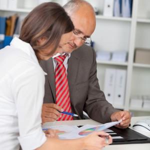 Woman receiving coaching from man