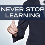 Man pointing to words 'never stop learning'